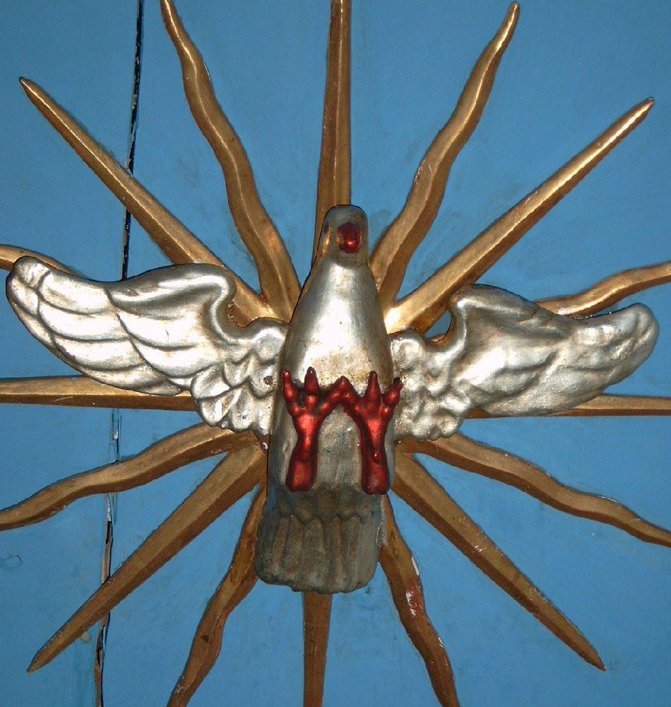 Taube, Symbol des Heiligen Geistes. Sie sitzt dem Prediger/in direkt auf dem Kopf
